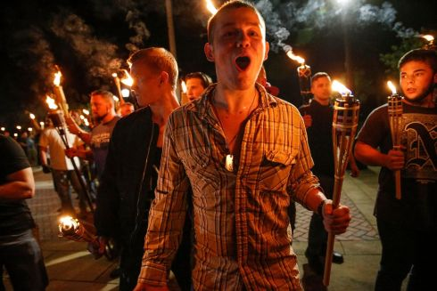 CHARLOTTESVILLE: Multiple white nationalist groups march with torches through the UVA campus in Charlottesville, Virginia. One protester died in clashes after far-right demonstrators opposed the proposed removal of a confederate statue. Photograph: Mykal McEldowney/The Indianapolis Star via AP