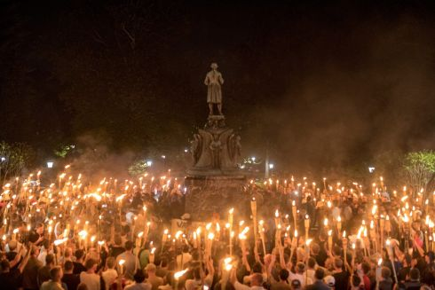 BURNING RAGE: Torch-bearing white nationalists rally around a statue of Robert E Lee, the Confederate general, near the University of Virginia campus in Charlottesville. Photograph: Edu Bayer/The New York Times