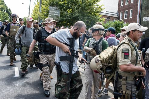 'LOCKED AND LOADED': A right-wing militia on the streets of Charlottesville, Virginia during violent confrontations between white nationalists and counterprotesters. Photograph: Edu Bayer/The New York Times
