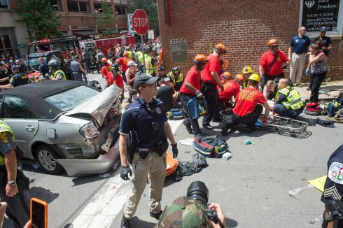 DARK DAY: A woman receives first-aid after a car ran into a crowd of protesters in Charlottesville, Virginia. Photograph: Paul J Richards/AFP/Getty Images
