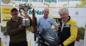 World Cup winner Geoffrey Hylands (left) with chairman Billy Burke and Tom Staunton of RS Marine