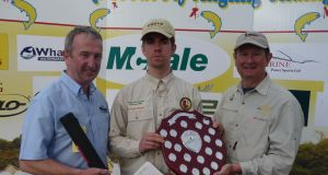 Best junior angler, Darragh Faherty from Renvyle, with committee member Kevin Egan (left) and Michael Twohig (sponsor)