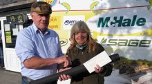 Best lady angler, Mary Miller, receiving her prize from committee president, Joe Cusack