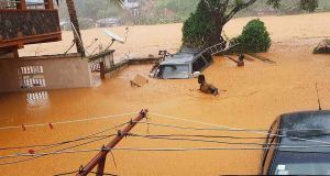 Flooded streets in Regent near Freetown, Sierra Leone, on Monday. Photograph: AFP/Getty Images