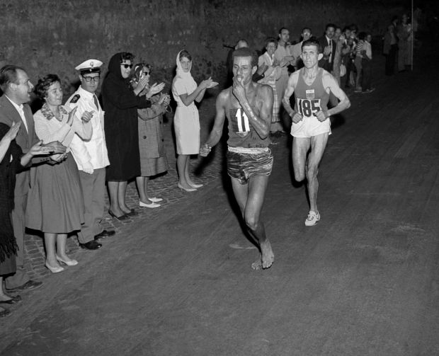 Ethiopian athlete Abebe Bikila runs barefoot for victory in the Rome 1960 Olympic Games marathon. Photograph: AFP/AFP/Getty Images