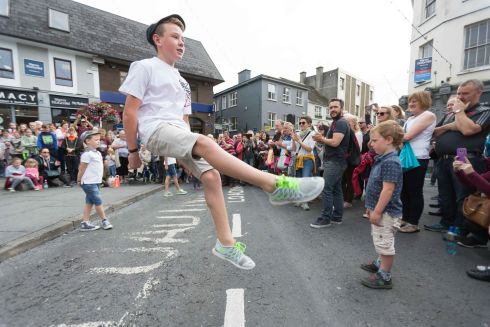FLYING FEET: Luka Byrne from Donegal dancing with his brothers Dempsey and Finn on O'Connell square at the Fleadh in Ennis on Monday. Photograph: Eamon Ward