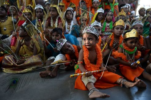 CELEBRATION TIME: Indian children dressed as Hindu deity Krishna gather at a temple during Krishna Janmashtami celebrations in Chennai. Photograph: Arun Sankar/AFP/Getty Images