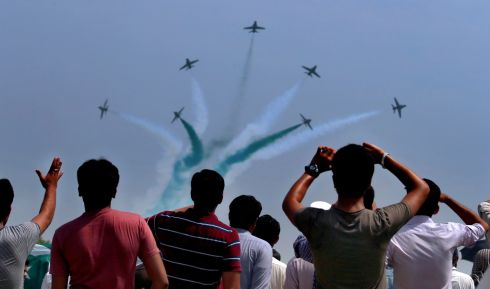 SOMETHING IN THE AIR: Spectators watch Pakistan Air Force fighter jets demonstrate an aerobatic maneuver during an air show to celebrate the 70th Independence Day in Islamabad. Photograph: Anjum Naveed/AP