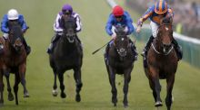 Churchill (Ryan Moore, right) wins the English 2000 Guineas at Newmarket in May. Photograph: Alan Crowhurst/Getty Images.