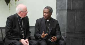 Archbishop Jude Thaddeus Okolo, the new Apostolic Nuncio to Ireland, is greeted by Cardinal Sean Brady on Monday. Photograph: John Mc Elroy