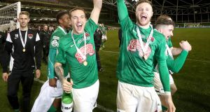 Cork's Karl Sheppard and Kevin O'Connor celebrate with the FAI Cup following last year's victory over Dundalk. Photograph: Ryan Byrne/Inpho