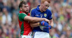 Kerry captain Johnny Buckley in action against Aidan O'Shea of Mayo in 2014. Photograph: Donall Farmer/Inpho