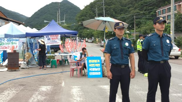Police are a permanent feature at the anti-Thaad protest camp at Soseong-gil in south central South Korea. Photograph: Peter Murtagh