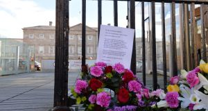 A wreath left at the gates of the Dáil on the first anniversary of then Taoiseach Enda Kennys apology to survivors of Magdalene laundries in 2014. Photograph: Alan Betson