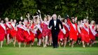 IN BLOOM: Presenter  Dáithí Ó Sé with contestants in the Rose of Tralee during a  photo call at Malahide Castle.  Photograph: Cyril Byrne / THE IRISH TIMES