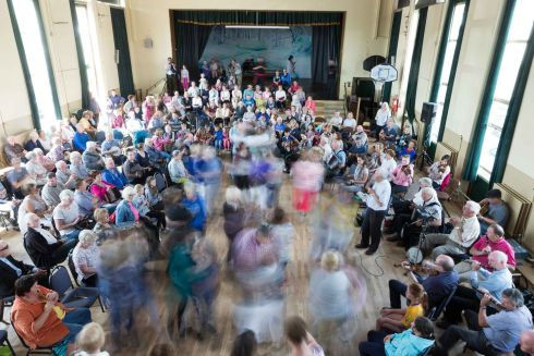 HOUSE AROUND: Dancing the Siege of Ennis during the Frank Custy session in the Holy Family Hall at the Fleadh in Ennis. Photograph: Eamon Ward