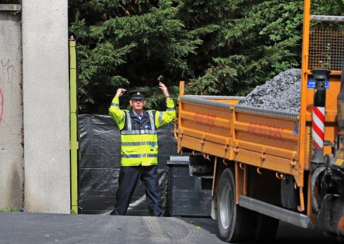 SEARCH CONTINUES: A truck carrying gravel arrives at the scene of the search for the body of Trevor Deely in Chapelizod, Co Dublin.  Photograph: Colin Keegan/Collins Dublin.