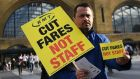 Members of the National Union of Rail, Maritime and Transport protest outside Kings Cross station on Tuesday. Commuters are facing an increase in rail fares by 3.6 per cent next year. Photograph: Andy Rain/EPA
