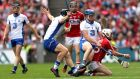 Waterford's Austin Gleeson pulls the helmet off Cork's Luke Meade in Sunday's All-Ireland hurling semi-final. Photograph: James Crombie/Inpho