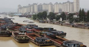 Cargo barges on a canal near  the city of Huzhou – scene of the 1995 murders for which Liu Yongbiao has been arrested. Photograph:  In Pictures Ltd/Corbis via Getty Images