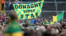 Kerry fans with a flag supporting Kieran Donaghy in 2014. Photograph: Cathal Noonan/Inpho