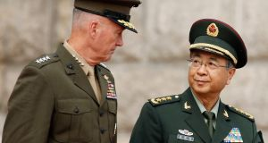 "US chairman of the joint chiefs of staff Gen Joseph Dunford, and his Chinese counterpart, Gen Fang Fenghui, in Beijing. Gen Fang said both sides should ""push forward stable military ties as an important and major stablising factor in bilateral relations"". Photograph:  Thomas Peter/Reuters"