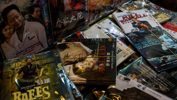 Fake DVDs of American films for sale in Shanghai. China is often portrayed as a land of fake gadgets and pirated software. Photograph: Chandan Khanna/AFP/Getty Images