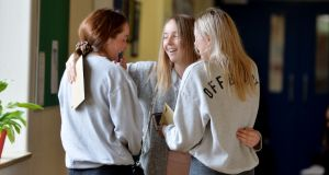 Suzanne Day, Aoife Moore and Charlotte Byrne delighted with their Leaving Certificate results and at Maryfield College, Whitehall. Photograph: Alan Betson/The Irish Times