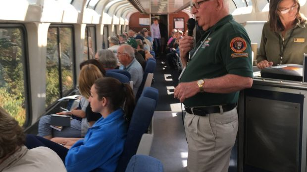 Passengers on the Amtrak train that crosses the Rocky Mountains on its way from Denver to Salt Lake City admire the view while hearing an account of the history of the area. Photograph: Suzanne Lynch