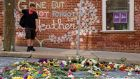 Jason Charter, of Washington stands at the site where Heather Heyer was killed during a white nationalist rally, Wednesday, Aug. 16, 2017, in Charlottesville, Va. Charter was at the scene when a car rammed into a crowd of people protesting the rally. (AP Photo/Evan Vucci)