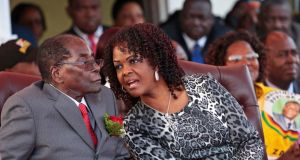 Grace Mugabe  speaks to her husband,   Zimbabwe president Robert Mugabe, at a 2016 event in Harare.