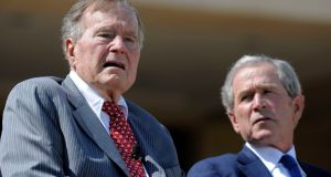 Former US presidents George H.W. Bush and George W. Bush pictured in April 2013. Photograph: Jewel Samad/AFP/Getty Images