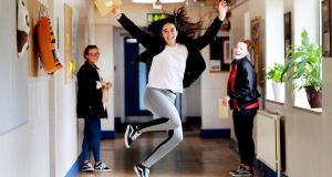 JUMP FOR JOY: Megan McCluskey and classmates Sarah Duffy and Ella Glynn celebrate their Leaving Cert results, at Maryfield College, Whitehall, Dublin. Photograph: Alan Betson/The Irish Times