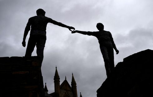 PEACE OFFERING: A silhouette of a peace statue entitled 'Hands Across the Divide', in Derry. Photograph: Clodagh Kilcoyne/Reuters