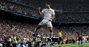 Real Madrid's Marco Asensio  celebrates scoring their opening goal during the Supercopa second  leg against  Barcelona at Estadio Santiago Bernabeu. Photograph: Gonzalo Arroyo Moreno/Getty Images