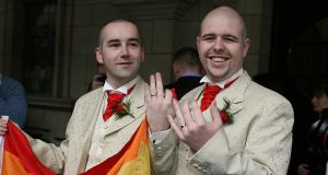 FHenry Edmond Kane and partner Christopher Patrick Flanagan outside Belfast City Hall after their civil partnership ceremony. File photograph: Paul Faith/PA Wire
