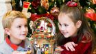 Hollie Walker (6) and Kyle Maloney (8) in the  Brown Thomas Christmas Shop in Dublin on Thursday. Photograph: Leon Farrell/Photocall Ireland