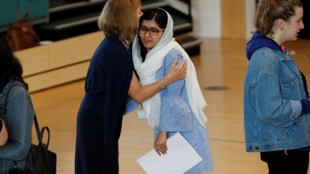 Taliban shooting victim Malala wins place at Oxford
