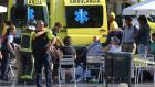 Injured people are treated in Barcelona. Photograph: Oriol Duran/AP