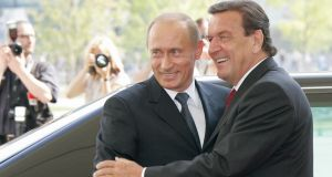 Gerhard Schroeder greets Russian president Vladimir Putin in Berlin in September 2005. Photograph: Vladimir Rodionov/AFP/Getty Images
