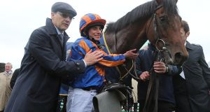 Aidan O'Brien and Ryan Moore with Churchill after winning the 2,000 Guineas at the Curragh in May. Lorraine O'Sullivan/Inpho