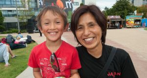 Yoshie Terada, from Japan, with her son Seamus Comer at the fanzone in UCD today.Photograph: Dave Meehan/The Irish Times