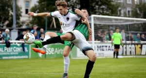 Cork City's Kieran Saldier with Ryan Brennan of Bray Wanderers. Photograph: Ryan Byrne/Inpho