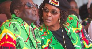 President Robert Mugabe and his wife Grace: Ms Mugabe is accused of assaulting a young model. Photograph: Tsvangirayi Mukwazhi/AP