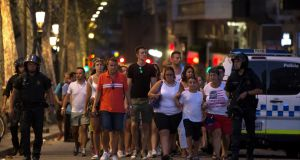 Police evacuate people after a van crashed into pedestrians near the Las Ramblas avenue in central. Photograph: Reuters