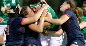 Ireland's Lindsay Peat is tackled during the Women's Rugby World Cup Pool C game against France at the  UCD Bowl. Photograph: Dan Sheridan/Inpho