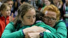 Ireland's Hannah Tyrrell is comforted by friends after the defeat to France in the Women's World Cup at the UCD Bowl. Photograph: Oisin Keniry/Inpho