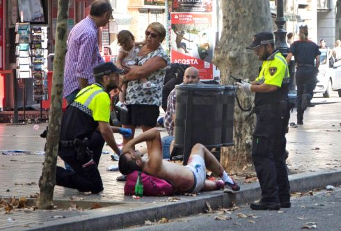 BARCELONA ATTACK: Police officers attend injured people after a van crashed into pedestrians, killing several, on Las Ramblas, downtown Barcelona, Spain. Photograph: David Armengou/EPA