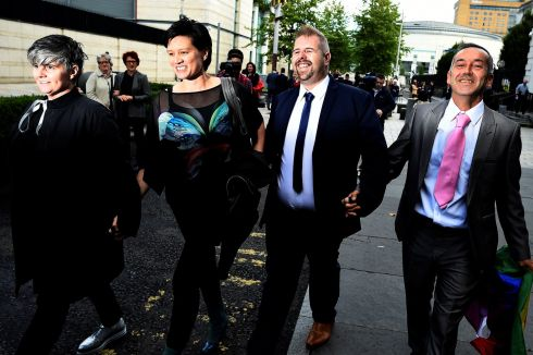 SAME-SEX MARRIAGE: Henry and Christopher Flanagan-Kane with Shannon Sickles and Grainne Close depart the High Court in Belfast after they lost their legal challenge to the North's ban on same-sex marriage. Photograph: Clodagh Kilcoyne/Reuters