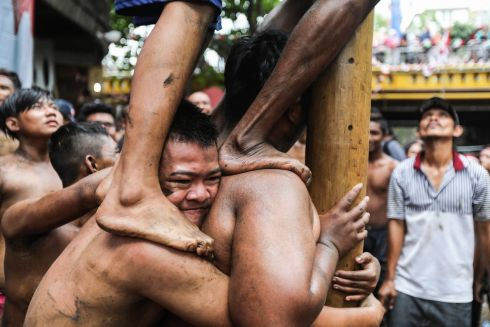 FIGHT FOR FREEDOM: Indonesian men climb a greased pole during celebrations to mark the 72nd anniversary of Indonesia's independence in Medan, North Sumatra. Indonesia gained its independence from the Netherlands in 1945. Photograph: Dedi Sinuhaji/EPA